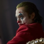 """This image released by Warner Bros. Pictures shows Joaquin Phoenix in a scene from """"Joker,"""" in theaters on Oct. 4. Alarmed by violence depicted in a trailer for the upcoming movie """"Joker,"""" some relatives of victims of the 2012 Aurora movie theater shooting asked distributor Warner Bros. on Tuesday to commit to gun control causes. Twelve people were killed in the suburban Denver theater during a midnight showing of the Batman film, """"The Dark Knight Rises,"""" also distributed by Warner Bros. (Niko Tavernise/Warner Bros. Pictures via AP)"""